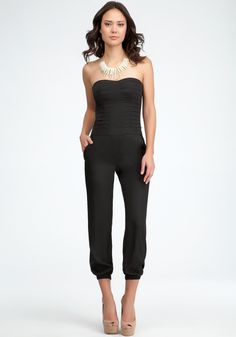 129.00 Pleated Bodice Jumpsuit Luxe pleated top; sexy heart-shaped neckline and flattering cinched hemline make this bebe jumpsuit an effortlessly-glam power piece.