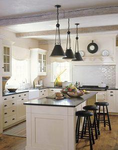 White kitchen dark counters dark hardware black pendants. Love it!