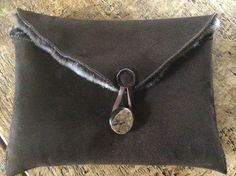 Sheepskin Mini iPad case, horn button and leather trim adds the finishing touches