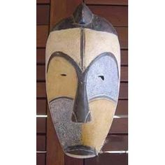 African Cameroon Fang Mask  Size: 38 cm x 23 cm  An African mask from the region of Cameroon that is crafted out of wood and set with the typical features of the Fang crafter's.
