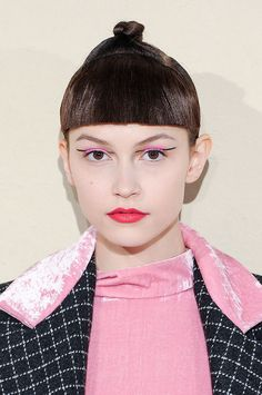Graphic eyeliner and a topknot // Tata Naka Fall 2015