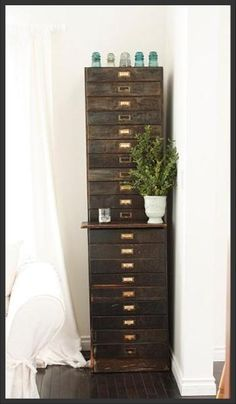 I would love to have a cabinet like this to store rubber stamps, paper, ribbon, etc in.
