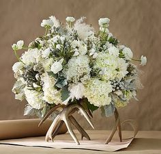 Centerpiece Pedestal Make a unique statement by elevating a floral arrangement. Instead of using the usual pedestal or wood slice, try crafting your antlers into an exceptional stand to showcase your floral centerpieces. Photo via Martha Stewart Weddings. Holiday Centerpieces, Floral Centerpieces, Wedding Centerpieces, Floral Arrangements, Wedding Decorations, Centrepieces, Flower Arrangement, Antler Decorations, Wedding Ideas