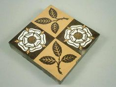 A Victorian Minton & Co patent tile, decorated in two shades of brown and white with a heraldic rose and a leaf, 15cm wide #tiles