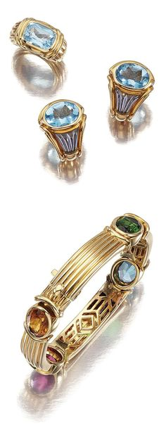 COLLECTION OF GEM-SET JEWELLERY, BULGARI.  Comprising: a bracelet, composed of fluted links, collet-set at intervals with oval citrine, blue topaz and tourmaline if various tints, length approximately 155mm, signed Bulgari, pouch; a pair of ear clips, each designed as stylised scrolls, set with carved iolite and an oval mixed-cut blue topaz, signed Bulgari, cased; and a ring centring on a cushion-shaped blue topaz, to a tapered and fluted band, size I, signed Bulgari, cased.