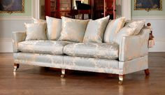 Inspired by the original pieces found in the collections of the Natural Trust, the Trafalgar is Duresta's most iconic sofa. It is a stunning statement piece and epitome of traditional British design and craftsmanship, with its elegant shape, drop arm, and beautifully hand carved, polished antique finish legs, finials and shrouds, and the feather filled back cushions that make it a dream to sit on.