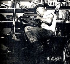 A young Kenny Howard (Von Dutch) perfecting his pinstriping craft at Bud Ekins' shop, 1965.  Before the cheesy namesake clothing and accessories line that threatens to destroy his cred forever, there was the self-invented and slightly mad genius Kenny Howard– better known asVon Dutch.He was a real Renaissance man– legendary custom painter, artist, motorcycle mechanic, and a skilled metal worker who hand-crafted his own knives and guns.   He had a strong aversion to money and felt i
