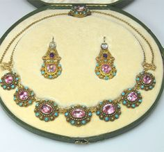 Georgian 18ct gold jewellery comprising of a necklace set with pink topaz, amethyst and turquoise and matching earrings. In original fitted box. Circa 1820.
