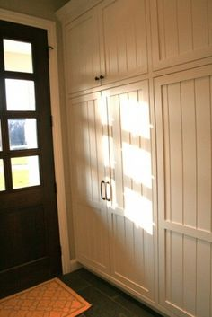 I want this! Built in cabinets to hide away the linen cupboard & laundry room in our dining room.