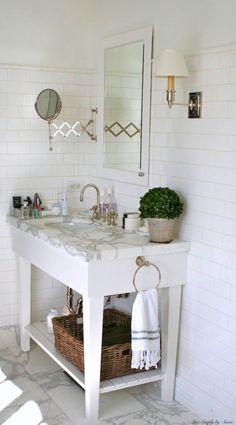 turkish hand towel, scissor mirror, looks like just one sconce ...