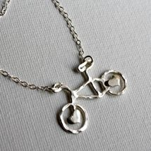 Tiny Sterling Silver Bike Necklace with  brass hearts from Rachel Pfeffer Designs