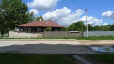 Fence line besides a log cabin/timber frame/glazed brick home in Vyksa Russia.