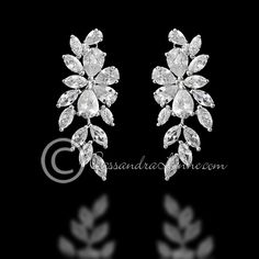 Bridal earrings of an exquisite teardrop & marquise flower and vine design. Post back, 1 3/8 inches long and 1/2 inch wide.