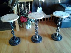 Handcrafted barstools.  Brake rotors,  discarded marine chain and pine seats!  Great job, honey! kandi11@msn.com