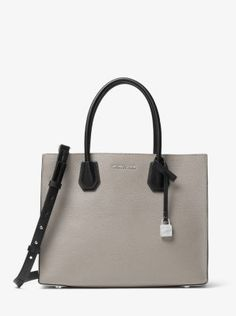 Crafted from pebbled leather, our tri-tone Mercer tote is a thoughtful update to a timeless silhouette. Tuck important items—such as your keys, phone and wallet—in the median zippered compartment, and carry it by its elegant top handles or go hands-free with the removable shoulder strap.
