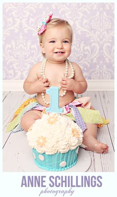 Anne Schillings Photography Children's portrait photographer. Cake smash one year old girl cupcake pink teal turquoise tutu bow purple birthday baby necklace pearl