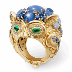"""This ring is inlaid with Star Sapphire, Sri Lanka sapphires, emeralds and diamonds, using gold ring as the base. This ring is a New York designer whose name is Temple St. Clair, launched in 2015 at the works of the Mythical Creatures series. It presents a habitat """"Owl"""" with a small body which gives people a very lovely impression. Cabochon cutting method is used for the precious stones."""