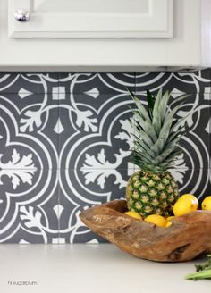 Hi Sugarplum | Make a splash in your Kitchen with inexpensive statement tile. See all the before & afters of a budget kitchen makeover