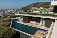 Stunning #fresnaye Villa with #swimming pool available for short term rental . Contact us on bookings@holidayvillascapetown.com #accommodation #Capetown #holidayvillascapetown Hillside Villas, Moon Dance, Bedroom With Ensuite, Cape Town, Swimming Pools, Relax, Mansions, House Styles, Top