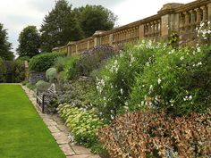 Beautiful garden wall <3  One of the original Lutyens designed benches, in a garden designed by Gertrude Jekyll