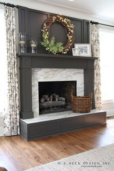 Beautiful color and millwork surrounding fireplace; surround in calcutta gold marble