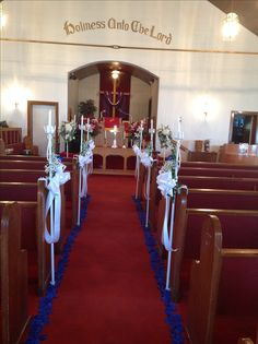 candelabras attach to pews and silk petals line the aisle