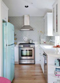 My dream kitchen: SMEG fridge, chimney range hood, and white cabinets.  Seriously, that fridge!