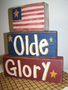 Old Glory sign stacking wooden blocks Americana 4th of July decor.