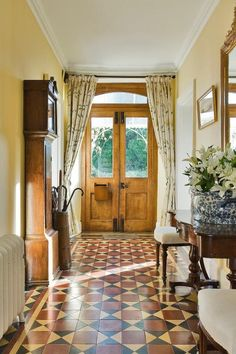 Liking the idea of pretty curtains to combat draughts in colder weather. Awesome entry in general. Hall Tiles, Tiled Hallway, Victorian Hallway, Victorian Tiles, Hallway Decorating, Entryway Decor, Hall Curtains, Small Country Homes, Hall Flooring
