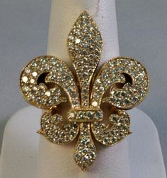 Platinum & 18k Yellow Gold Fancy Yellow Diamond Ring  ~I have this crazy love for anything with a Fleur de Lis...come to find out The French word Fleur de Lis meaning is ~Lily......How awesome is that! My lil Lily, My lil Fleur de Lis :)
