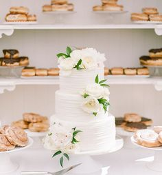 Have more than one sweet tooth? Opt for a classic #weddingcake and an extra round of your favorite sweet treats! We promise, your guests will *not* be complaining #marthaweddings : @rebeccayale | : @simplysweetbyjessica | : @sincerelygingerweddings | : @bloomfloraldesign
