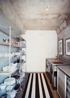 open industrial shelving + striped rug = awesome.