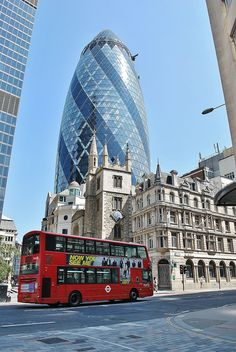 30 St Mary Axe-The Gherkin - London, designed by Norman Foster.. You can also see St Andrew Undershaft church, built in 1532 on the site of two earlier churches