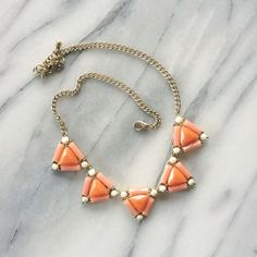 """Triangles Necklace Sweet blush, ivory and coral triangle gems necklace with gold chain. Approx. 18"""" long. Worn once, no stones missing, perfect condition. Listing is for necklace only. Francesca's Collections Jewelry Necklaces"""