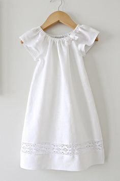 This is such a pretty natural dress with angel sleeves in a beautiful soft white pure linen with a pure white cotton lace insert and finished with a