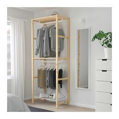 IKEA - IVAR, Shelving unit with clothes rail, Untreated solid wood is a durable natural material which is even more hardwearing and easy to look after if you oil or wax the surface. You can move shelves and adapt spacing to suit your needs. Open Wardrobe, Simple Wardrobe, Clothes Rail Ikea, Ikea Ivar Regal, Ikea Ivar Shelves, Dressing Ikea, Metal Shelving Units, Shelf System, Garment Racks