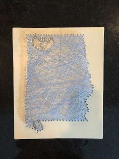 String Art Tutorial with design ideas. Nail art makes a great personalized gift. Easy and cheap gifts! This string art design was for a wedding gift for a couple in neighboring towns in Alabama.