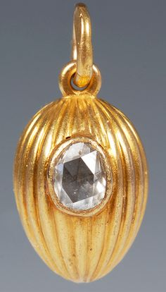 A Russian gold and diamond pendant egg, Cyrillic maker's mark GD, St Petersburg, prior to 1899. From John Atzbach.