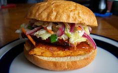 Spicy Barbecue Tempeh Sandwiches  For the tempeh:  2 8-oz packages unflavored tempeh  ¾ cup barbecue sauce   1 cup beer or vegetable stock  2 T chipotle hot sauce    For the slaw:  1 bag shredded carrots and cabbage  ½ red onion, thinly sliced  Juice of 1 lemon  1 tsp Dijon mustard  2 Tbsp olive oil  1 tsp sugar  Salt and Pepper