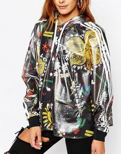 adidas Originals | Chaqueta tipo poncho con estampado de festival con 3 rayas Pharrell Williams de Adidas Originals