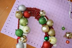 Monogram letter door decorating covered with beads then Christmas ornaments-