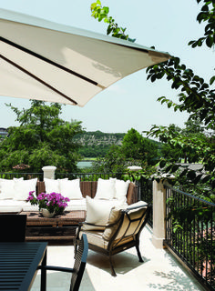 Situated just off the kitchen, dining- and living-room areas, the veranda overlooks Lake Austin's limestone cliffs. Outdoor furnishings from...