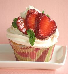 These cupcakes are so delish! Sarah's famously moist Ultimate Butter Cake, flavored with strawberries, filled with fresh strawberry filling and topped with whipped cream and a heart-shaped strawberry fan. It doesn't get any better than this!