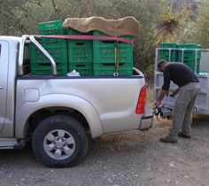Zero Sitias olives in crates Greek Olives, Olive Oil, Crates, Monster Trucks, Zero, Shipping Crates, Drawers, Barrel