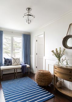 Foyer Ideas. Classic foyer with blue and white decor. Pillows are by F. Schumacher & Co. The bench was purchased from Restoration Hardware. #Foyer #Blueandwhite #FSchumacherandCo Chango & Co.