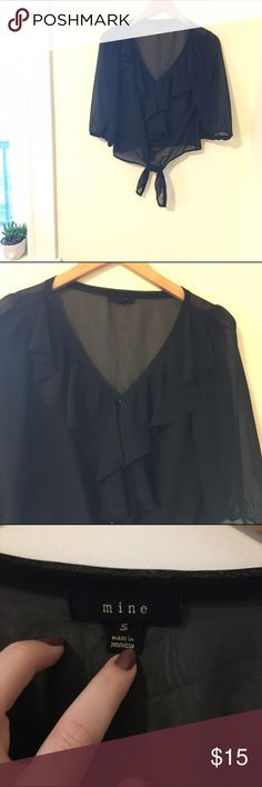 Sheer ruffle black blouse Great condition! Sheer throughout. Buttons up the front with ruffles on top. The bottom has a tie-waist. Super cute for going out with a cute bra underneath, but also appropriate for work with a tank underneath instead! From small boutique but similar to Topshop. Topshop Tops