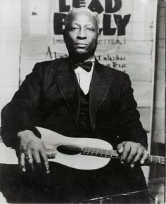 Lead Belly - An American Folk and Blues Musician and Multi-Instrumentalist :: He is known for his strong vocals, and his style of playing on the twelve-string guitar. He introduced an entire songbook of folk standards to the community of the American folk revival. #GraveyardGreats #LeadBelly