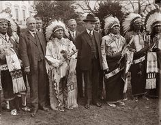 This picture was taken in 1925, and shows Calvin Coolidge on the lawn of the White House with a group of Native Americans. No one looks too happy in the picture.