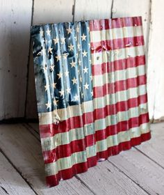 An old piece of corrugated tin painted to look like an American flag.