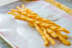 These puffy Cheddar Cheese Twists have a sharp and buttery flavor, and are very easy to make. They are perfect for parties and entertaining! Appetizer Dips, Appetizer Recipes, Snack Recipes, Cooking Recipes, Savory Snacks, Cheese Recipes, Healthy Snacks, Dinner Recipes, Healthy Recipes